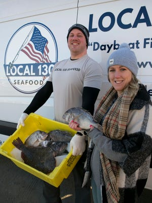 Eric Morris, CEO of Local 130 Seafood in Asbury Park, and Kat Sorensen, his retail manager, with some of his fresh fish.