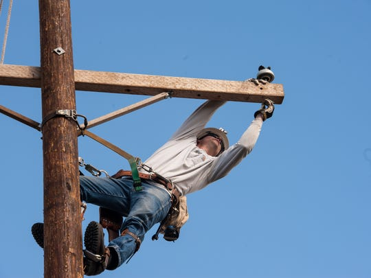 A JCP&L employee demonstrates working high up on a pole at the utility's training center in Howell.