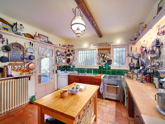 The kitchen in Julia Child's home in Provence is a replica of the one she used in Cambridge, Massachusetts. which is now in the Smithsonian.