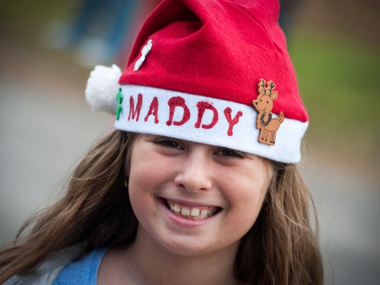 Maddy York, 9, Neptune, shows off her hat. Christmas at Allaire was held at The Historic Village at Allaire in Farmingdale, NJ, on Sunday, December 13, 2015.