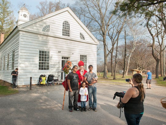 St. Nichoas as played by Bill Gerhauser, Trenton, posed for photos in front of the Village chapel. Susan Joseph, Neptune City, takes photos of her children Kayshawn (left) Kyonna, 5, and Kylar who is holding Khloe, 6 months. Christmas at Allaire was held at The Historic Village at Allaire in Farmingdale, NJ, on Sunday, December 13, 2015.