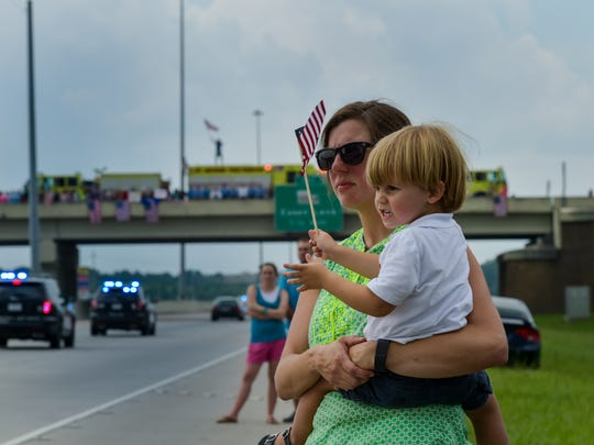 katie freeman and her son Sebastian stand on I-10 to pay respects to Baton Rouge Police officers Matthew Gerald. July 22, 2016.