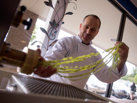 Chef Michele D'Oto making spinach tagliatelle in 2016.