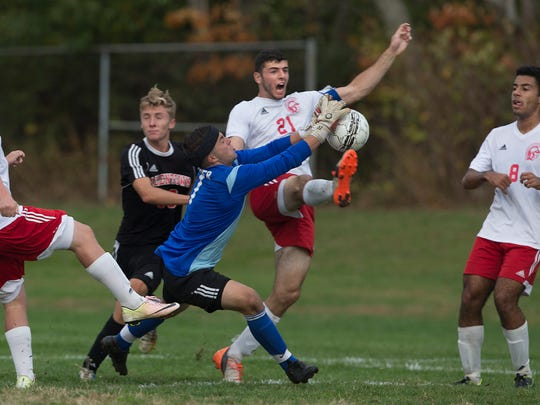 Allentown goalie Joe Jurik tries to pull in the ball before Ocean's Thomas Amato can get his foot on it. Allentown vs Ocean Twp Boys Soccer in State Playoff game in Ocean Township, NJ on November 3, 2016