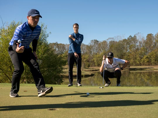 November 11, 2016 - Golfers (from left) KC Griffin, Joe Salisbury, and Chris Doerr consider their shots on a green at Mirimichi Golf Course in Millington, Tenn.