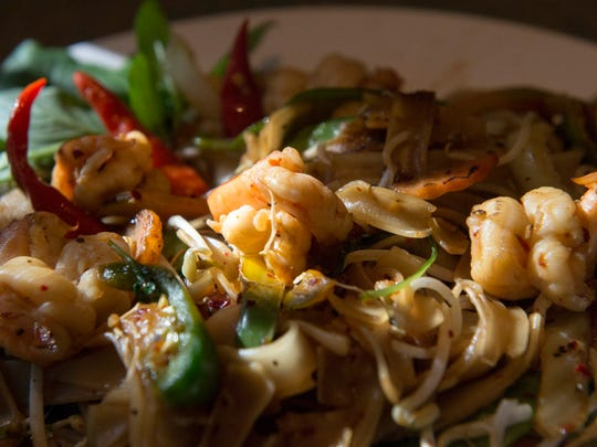 Jasmine Thai and Vegetarian restaurant offers this shrimp pad kee mao (drunken noodle) entree at their Cooper Young location. The dish features shrimp and sauteed flat noodles with fresh basil, bean sprouts, carrots, jalapenos, onions and vegetables in a spicy thick soy sauce.