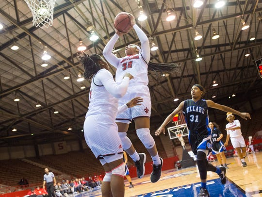 Simone Fields shoots the ball for two. Cajuns basketball