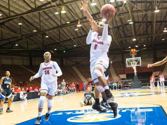 UL freshman guard Jasmine Thomas takes the ball to the basket during a Cajuns' win earlier this season at Blackham Coliseum.