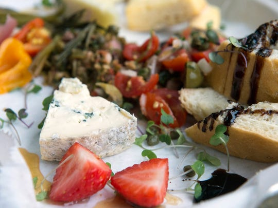 Loflin Yard offers this cheese plate with three varieties