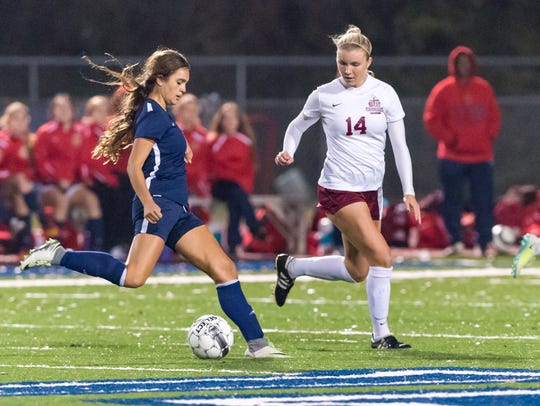 St. Thomas More's Colleen Vidos (14), shown here defending against Teurlings Catholic earlier this season before her latest knee injury, is hoping to be able to finish off with career on the field with a state championship trophy.