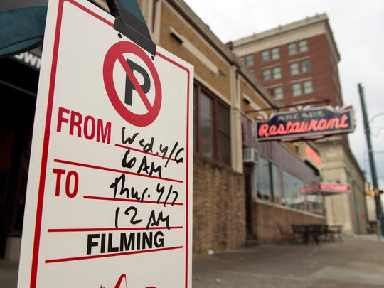 """A no parking sign is posted on the street near the Arcade Restaurant druing filming of the """"Million Dollar Quartet"""" television show in April, 2016."""