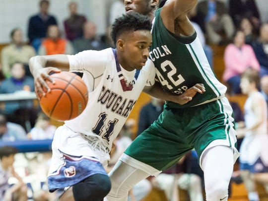 Jonathan Cissie takes it to the basket as STM takes on Lincoln Prep in the Sunkist Shootout. Thursday, Dec. 29, 2016.