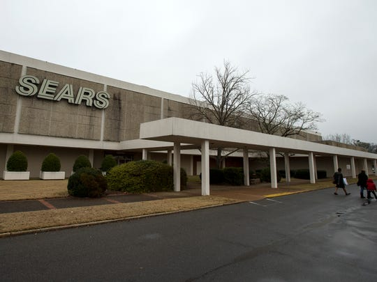 January 15, 2016 - Customers walk through the parking lot of the Sears store at 4570 Poplar in the Laurelwood shopping center. Officials with Sears have confirmed that the company will close the store in April.