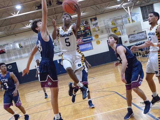 Travis Zeno takes it to the basket as Carencro takes