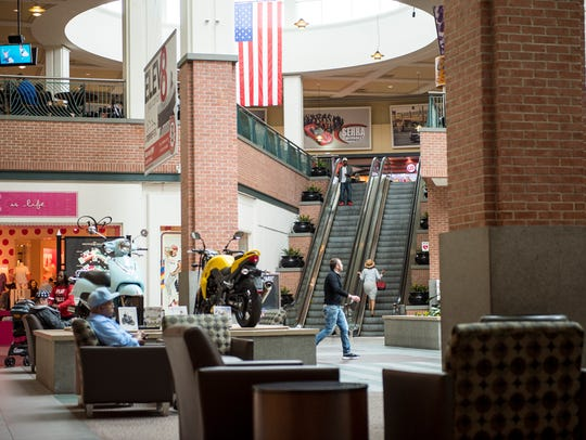 Shoppers wander inside Wolfchase Galleria in this 2016 photo.