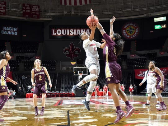 UL's Jaylyn Gordon takes it to the hoop during her 20-point performance in the win over Texas State.
