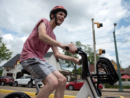 Andrew O'Sullivan tries out a bicycle from Explore Bike Share at a demonstration at Overton Square on July 27, 2016.