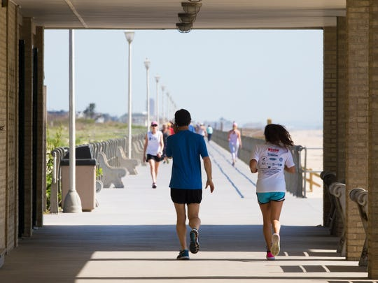 Early morning exercisers pass through one of the pavillions