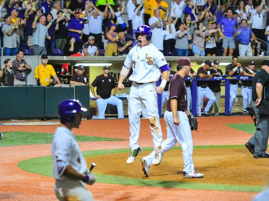 Josh Smith celebrates after scoring a run as Mississippi