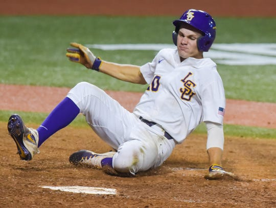 Antoine Duplantis slides into home to score a run against Mississippi State at Alex Box Stadium in Baton Rouge.
