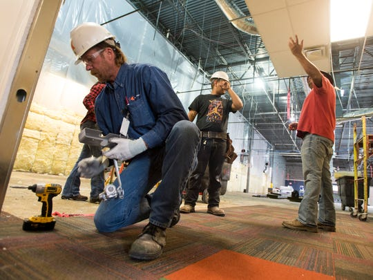 October 21, 2015 - Superintendent Tim Cowan (left) and others work at the Accredo office construction site in Cordova. The company is in the midst of a major expansion and renovation. (Brandon Dill/Special to The Commercial Appeal)