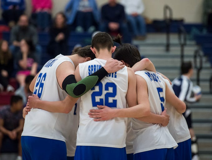 The Spring Grove volleyball team huddle up before taking