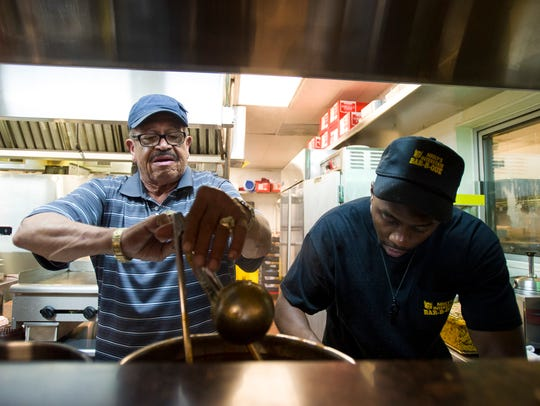 Jim Neely (left) works alongside Jay Goods at Neely's Interstate Bar-B-Que.