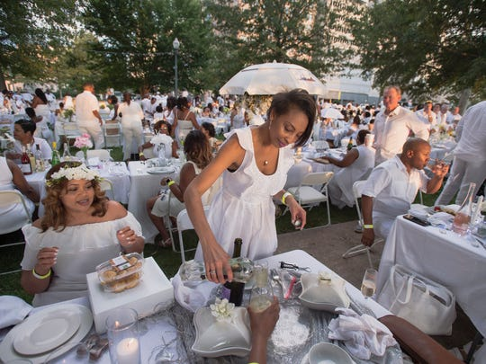 August 4, 2018 - Scenes from Le Dîner en Blanc event at Memphis Park. Hundreds of  guests were transported to the event's secret location via chartered buses. Attendees brought their own formal picnic wear and were required to dress in all white, from head to toe. The pop-up posh picnic has taken place in more than 70 cities worldwide.