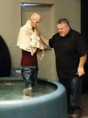 Travis Lane at his baptism. Travis Lane was killed in a hit-and-run crash May 23 while walking home.