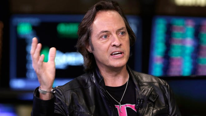 T-Mobile CEO John Legere is interviewed on the floor of the New York Stock Exchange last October.