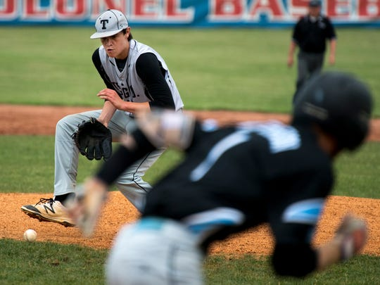Trigg County pitcher Ashton Plymale fields a bunt from a Union County batter during their Second Region semifinal baseball tournament at Christian County High School in Hopkinsville, Ky., Wednesday evening.