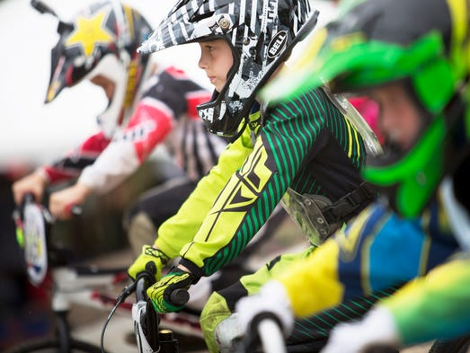 """Riders lined up before the sratr of a race.  The USA BMX Derby City Nationals event was held at E. P. """"Tom"""" Sawyer State Park in Louisville from Friday to Sunday."""