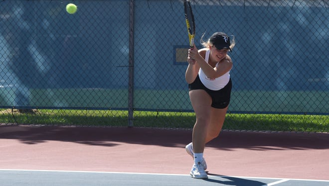 Lincoln High School Johana Brower hits the ball during a tennis match against Yankton High School in Sioux Falls, S.D. at Lincoln High School on Tuesday, Sept. 11, 2018.