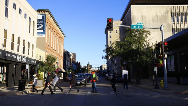 Protesters march across the crosswalk at East State and First streets on Friday in downtown Rockford. Demonstrations have been ongoing this summer against racism and police brutality.