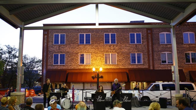 Jodi Beach performs Friday during the final Rockford City Market of the season.