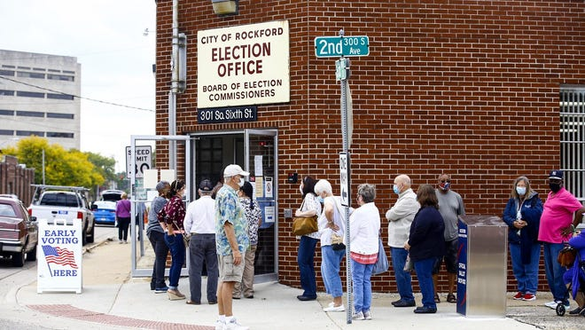 Voters line up Thursday outside the Rockford Board of Elections office, 301 S. Sixth St., on the first day of early voting in Illinois.