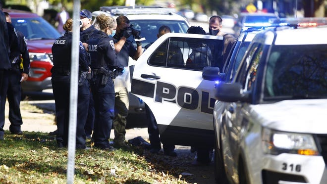Police talk with a person of interest on Thursday, Oct. 15, 2020, after a 3-year-old child was shot in the 800 block of North Court Street in Rockford.