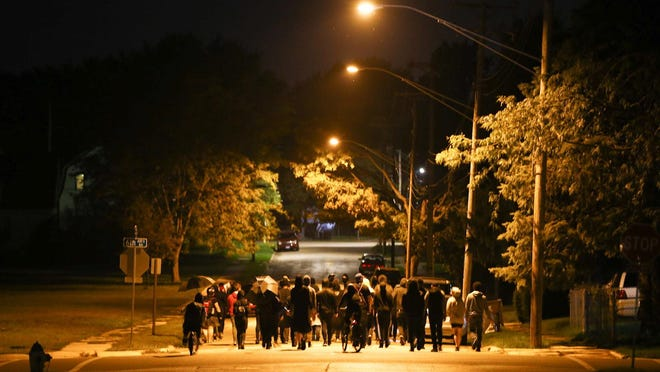 Protesters march down 15th Street toward Charles Street in Rockford on Wednesday, Sept. 23, 2020, in response to a grand jury decision to charge one of three officers involved in the shooting death of Breonna Taylor.