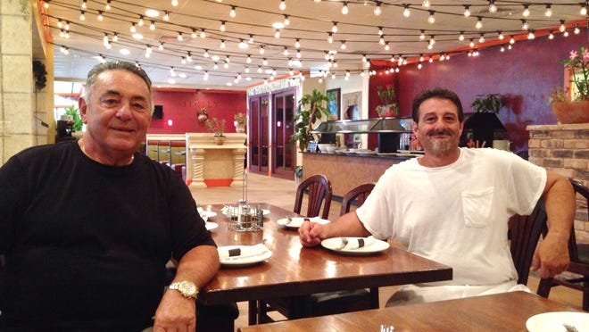 Antonino Basile and his son, Vincent, sit in the dining room of Mama Nina's, Basile's new Italian and Mexican eatery in San Carlos Park.