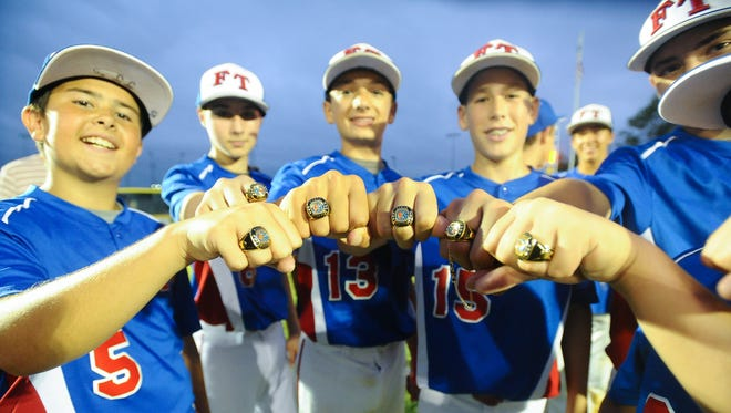 Freehold Township players, from left, J.J. Donahue, Brandon Levy, Brad Salamone and Colin Reilly  show off their New Jersey Little League State Championship rings after defeating Upper Township 14-1 in Gloucester City, Monday, Aug. 1, 2016. Joe Warner/ Special to the Press