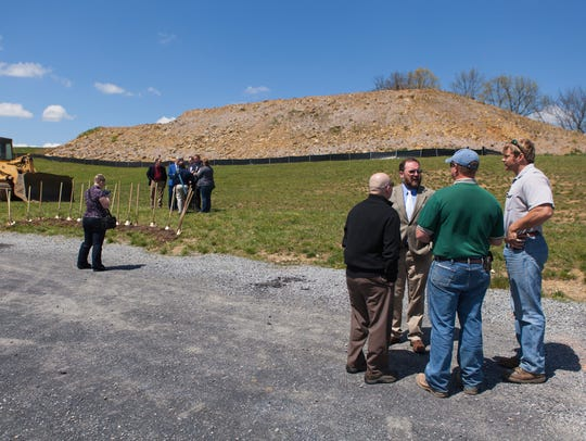 Attendees stand at the site of Nexus Services' groundbreaking