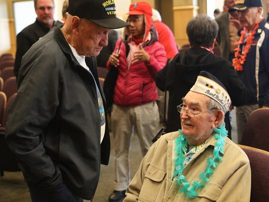Gaylord Bedell, left, talks to Pearl Harbor survivor,