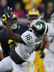 Michigan's Jourdan Lewis breaks up a pass thrown to Michigan State's Aaron Burbridge in the Wolverines' 27-23 loss Oct. 17.