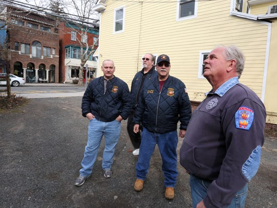 Piermont Fire Department's Daniel Goswick, Alan Bartley, Chief Don Hardy and Kevin Fagan at the site of a fire that killed three children 40 years ago on Piermont Ave. March 1, 2018.