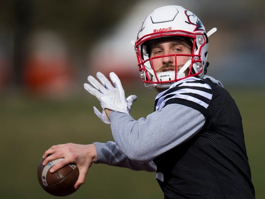 Quarterback Aaron Zwahlen throws the ball during the