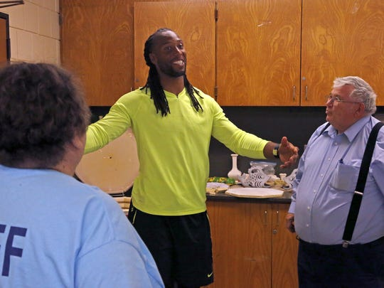 Larry Fitzgerald visits friends and mentors Eunice and David Rudolph at the Martin Luther King Park.