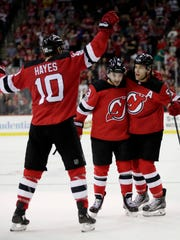 New Jersey Devils left wing Taylor Hall, right, celebrates