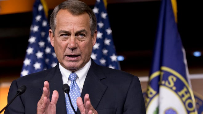 House Speaker John Boehner of Ohio responds to reporters' questions during a news conference on Capitol Hill in Washington.