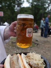 Sausages and a stein of beer are photographed at the