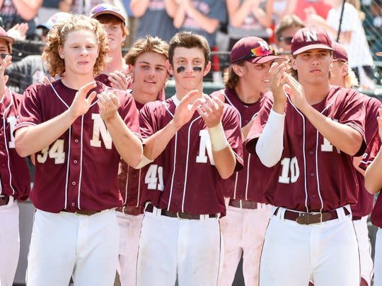 Newman Catholic celebrates their win on Saturday, August 1, 2015, during the 1-A state baseball finals.